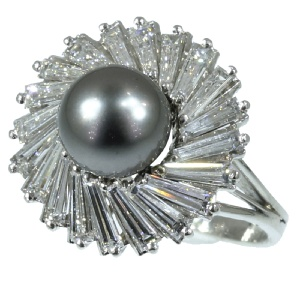 Exceptional platinum estate ring with tapered baguette diamonds and black pearl